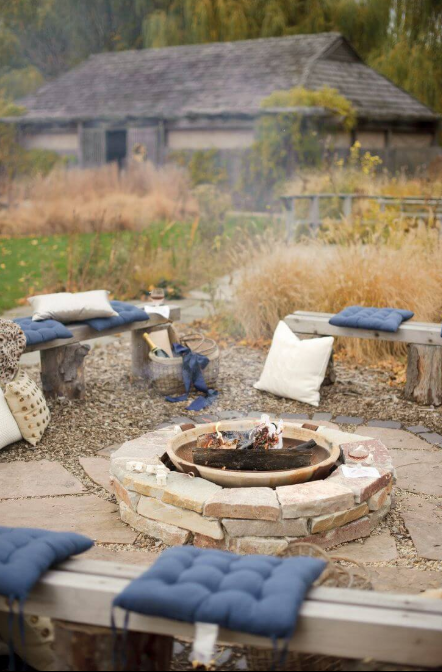 A Backyard Fire Hole With Comfortable Cushions