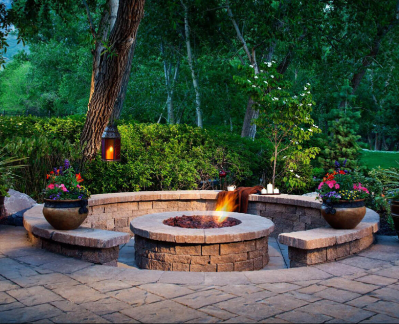 A Firepit Enhanced by Shrubs and Flowers