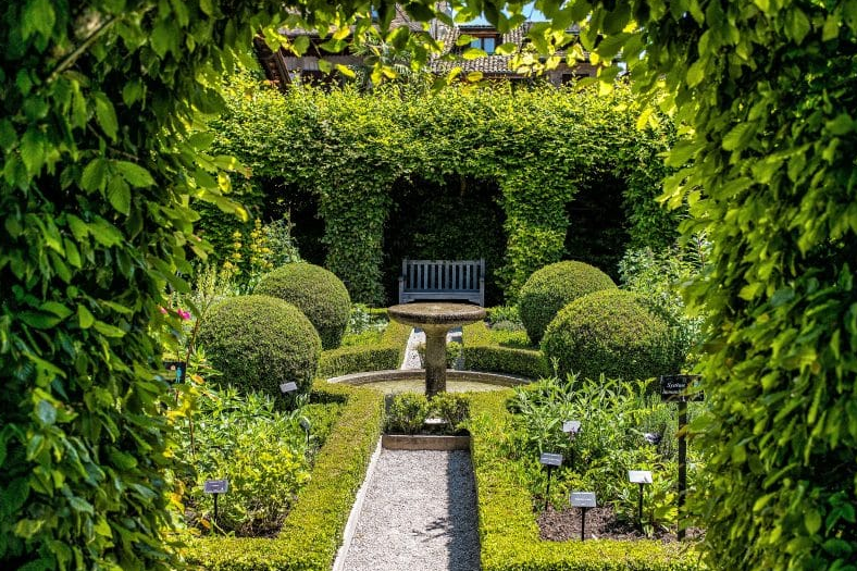 garden design ideas - Nestled Under Arches