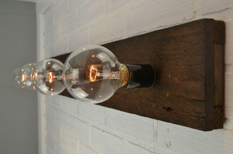 Vintage Fence Pickets Make for a Stunning Vanity Light